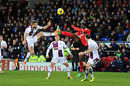 Aston Villa's Nathan Baker (l) challenges Cardiff's Kenwyne Jones ® for the ball. Barclays Premier league, Cardiff city v Aston Villa match at the Cardiff city Stadium in Cardiff, South Wales on Tuesday 11th Feb 2014.<br /> pic by Andrew Orchard, Andrew Orchard sports photography.