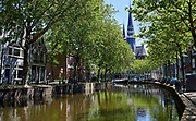 Canal with view on the Gouwekerk in dutch city Gouda, Netherlands