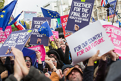 """London, UK. 19 October, 2019. Tens of thousands of pro-EU citizens celebrate at a People's Vote rally in Parliament Square as news comes through of the passing during a 'super Saturday' House of Commons session of a motion tabled by Independent MP Sir Oliver Letwin that """"withholds approval"""" for Prime Minister Boris Johnson's Brexit deal until legislation implementing it has been passed."""