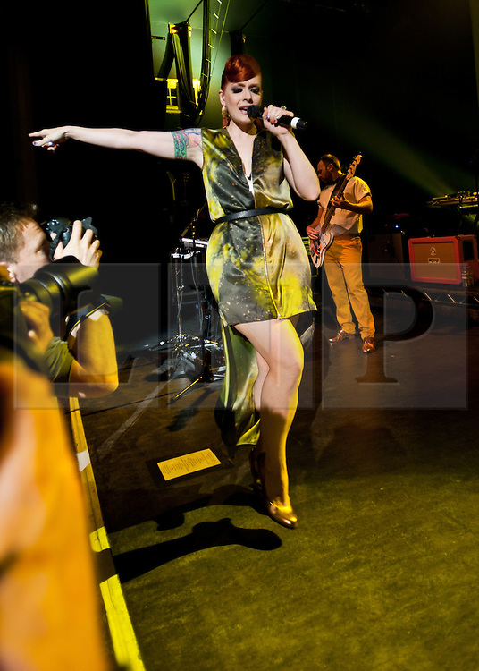 """© Licensed to London News Pictures. 16/05/2012. London, UK. Scissor Sisters perform live at O2 Shepherd's Bush Empire.  They are to perform as part of London's Olympic Festival on the BT River of Music America's Stage during the weekend of the 21-22 July 2012.  The group's fourth album """"Magic Hour"""" is due to be released on 28th May.  Scissor Sisters are an American band, formed in 2001, the band """"spawned by the scuzzy, gay nightlife scene of New York"""".  Its members comprise Jake Shears and Ana Matronic as vocalists, Babydaddy as multi-instrumentalist, Del Marquis as lead guitar/bassist, and Randy Real as drummer.  In this picture - Ana Matronic.  Photo credit : Richard Isaac/LNP"""