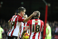 Brentford midfielder Sergi Canos congratulating Brentford midfielder Alan Judge after winning a penalty during the Sky Bet Championship match between Brentford and Huddersfield Town at Griffin Park, London, England on 19 December 2015. Photo by Matthew Redman.