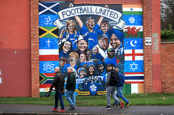 A general view of fans walking past a Leicester City mural prior to the Premier League match at the King Power Stadium, Leicester.