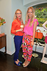 Left to right, ASHLEY WARWA and MARTHA WARD at a 'Tropical fete' at Kate Spade New York, 2 Symons Street, Sloane Square, London in celebration of the Chelsea Flower Show on 22nd May 2014.