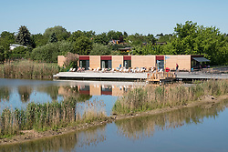 Campis Pavilion outdoor cafe overlooking wetland and pond at IGA 2017 International Garden Festival (International Garten Ausstellung) in Berlin, Germany