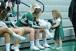 21 February 2017:  Titan cheerleaders with a younger cheerleader during an College men's division 3 CCIW basketball game between the Augustana Vikings and the Illinois Wesleyan Titans in Shirk Center, Bloomington IL