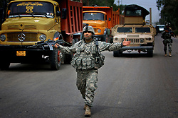Engineers with 1st Platoon Alpha Co. 3-25 BSTB 2BCT 82nd Airborne Division carrying out a snap checkpoint to check for suspicious vehicles and passengers moving between contested Sunni and Shia districts on Sunday April 22, 2007