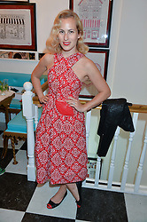 CHARLOTTE DELLAL at a party to launch Biscuiteers Fashion Biscuit Collection inspired by Alice Naylor-Leyland's wardrobe held at Biscuiteers, 194 Kensington Park Road, London W11 on 23rd June 2015.