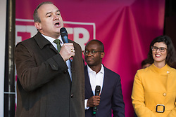 London, UK. 19 October, 2019. Sir Ed Davey, Deputy Leader of the Liberal Democrats, seen here with Sam Gyimah MP and Layla Moran MP, addresses hundreds of thousands of pro-EU citizens at a Together for the Final Say People's Vote rally in Parliament Square as MPs meet in a 'super Saturday' Commons session, the first such sitting since the Falklands conflict, to vote, subject to the Sir Oliver Letwin amendment, on the Brexit deal negotiated by Prime Minister Boris Johnson with the European Union.