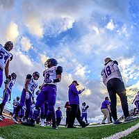 The Miyamura Patriots take to the sidelines to face the St. Pius X Sartans at Wilson Stadium in Albuquerque Thursday.