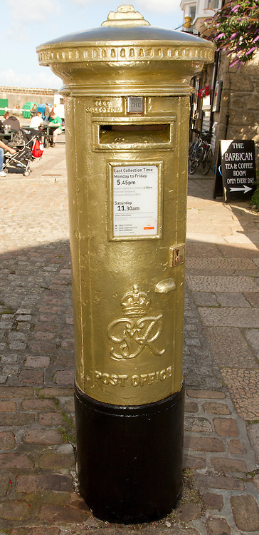 © Licensed to London News Pictures. 02/08/2012. Penzance, UK. A Gold painted Royal Mail post box in Penzance, the home town of Olympic Gold Medal winner Helen Glover. Helen, along with crew mate Heather Stanning won Great Britain's first Gold medal of the London Olympic games in the women's pairs rowing. Photo credit : Ashley Hugo/LNP