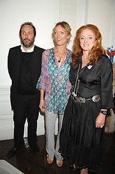 Left to right, the HON.DAVID MACMILLAN, MELANIE METCALFE and CAMILLA LOWTHER at a lunch in aid of African Solutions To African Problems held at Il Bottaccio, 9 Grosvenor Place, London on 20th May 2008.<br />