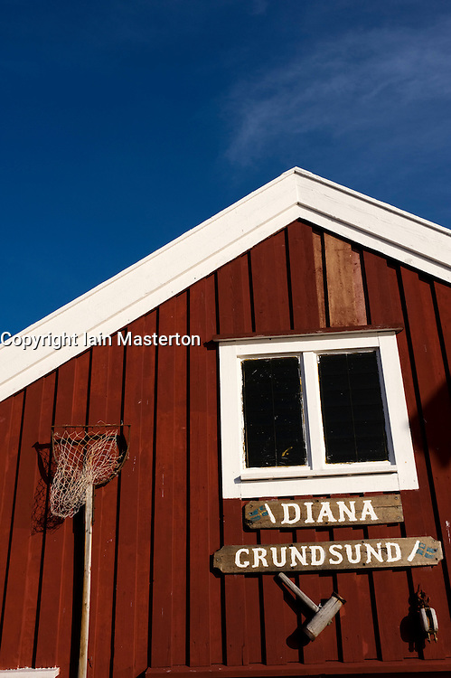 Detail of traditional red wooden boathouse in village of Grundsund on Sweden`s Bohuslan coast