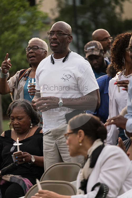 Relatives of the Emanuel 9, killed in a mass shooting at the historic Mother Emanuel African Methodist Episcopal Church, light candles during the Pray for America service marking the 4th anniversary of the mass shooting June 19, 2019 in Charleston, South Carolina. Nine members of the historically black congregation were gunned down during bible study by a white supremacist on June 17, 2015.