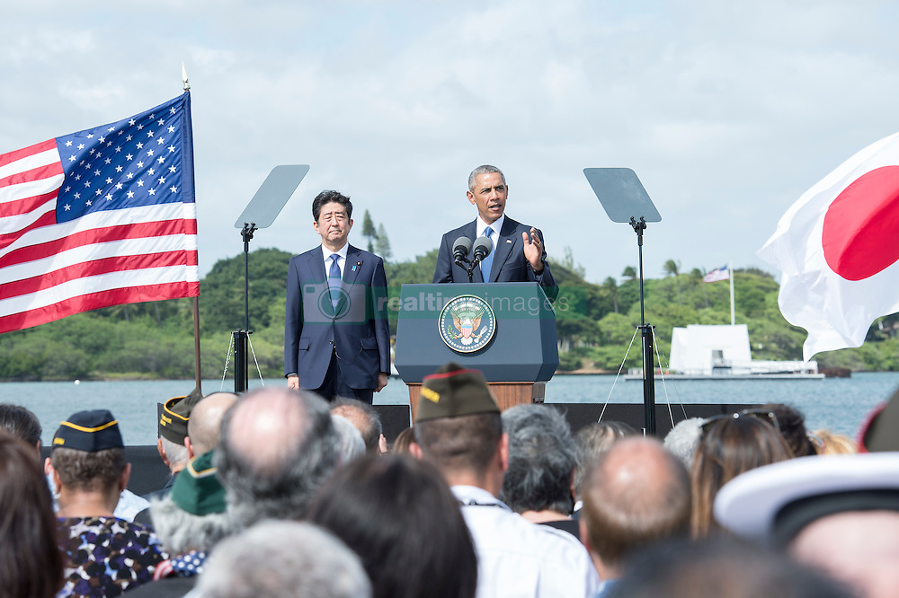 U.S. President Barack Obama speaks on Kilo Pier at Joint Base Pearl Harbor-Hickam, while Japanese Prime Minister looks on, in Hawaii, USA, on December 27, 2016. Abe is the first Japanese prime minister to visit the USS Arizona Memorial. Photo by DOD via Balkis Press/ABACAPRESS.COM
