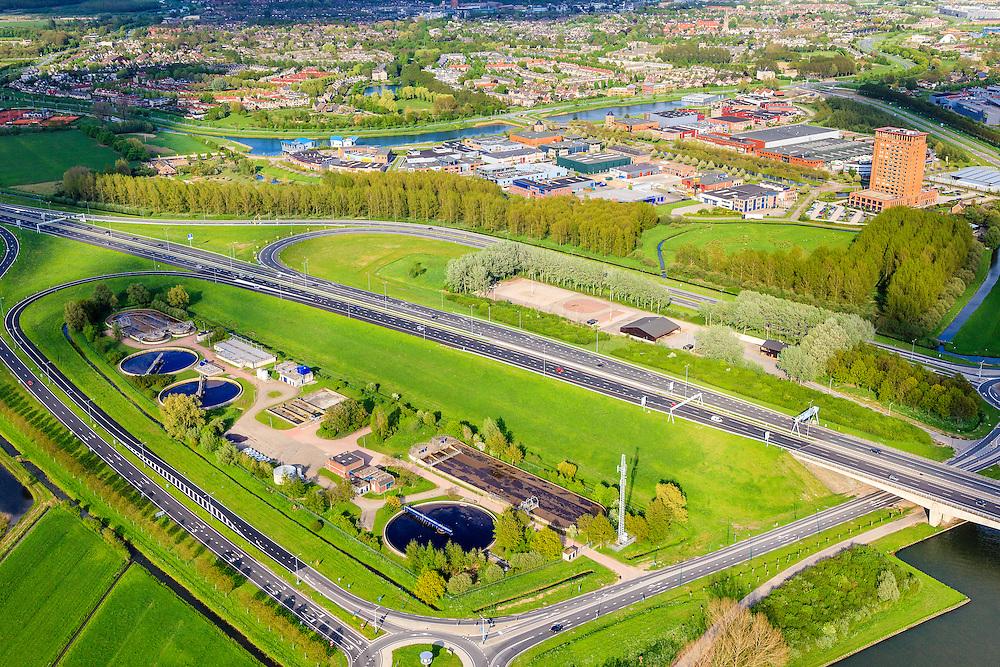 Nederland, Utrecht, Houten, 09-05-2013; rioolwaterzuivering in de 'oksel' van de afslag Houten (A27)<br /> Sewage treatment plant, surrounded by motorway exit, near Utrecht.<br /> luchtfoto (toeslag op standard tarieven)<br /> aerial photo (additional fee required)<br /> copyright foto/photo Siebe Swart