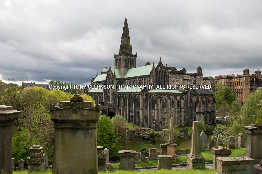 Atmospheric skies over Glasgow Cathedral, also called the High Kirk of Glasgow or St Kentigern's or St Mungo's Cathedral viewed from the Victorian cemetery the Glasgow Necropolis.
