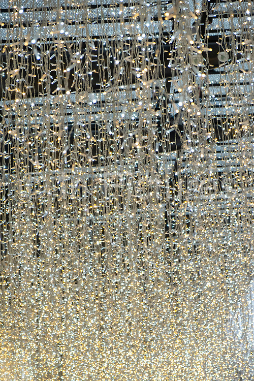Fairy lights create a raining light type scene outside the exclisive Berkley Hotel in London, United Kingdom. The Berkeley is a five star deluxe hotel located in Knightsbridge. It is managed by the Maybourne Hotel Group.