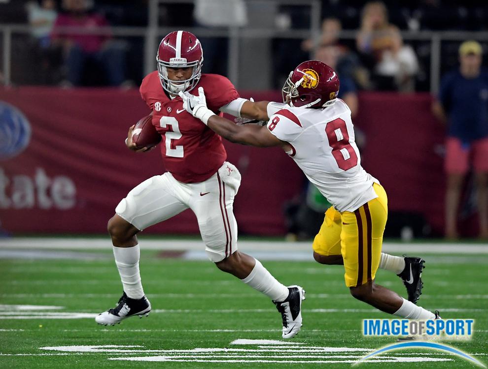 Sep 3, 2016; Arlington, TX, USA; Alabama Crimson Tide quarterback Jalen Hurts (2) stiff arms USC Trojans defensive back Iman Marshall (8) during the second half at AT&T Stadium.