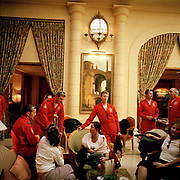 Pilots of the Red Arrows, Britain's RAF aerobatic team gather in hotel after their Bastille Day flypast over Paris. After arriving back on the ground and their Paris hotel, the British officers meet wives and girlfriends after ending France's Bastille Day parade. They were chosen by the French authorities to close the fly-pasts. British armed forces paraded in the historic parade for the first time. Under blue skies on a perfect summer day, the squadron lined up in their classic fly-past 'V-shape' called 'Big Battle', following the straight line of the Champs Elysees then eastwards over the Parisian suburbs. Personnel from four British military units were present and French Air Force jets performed their own fly-past to open the parade, while the British Hawk jets of the Red Arrows had the honour of completing it.