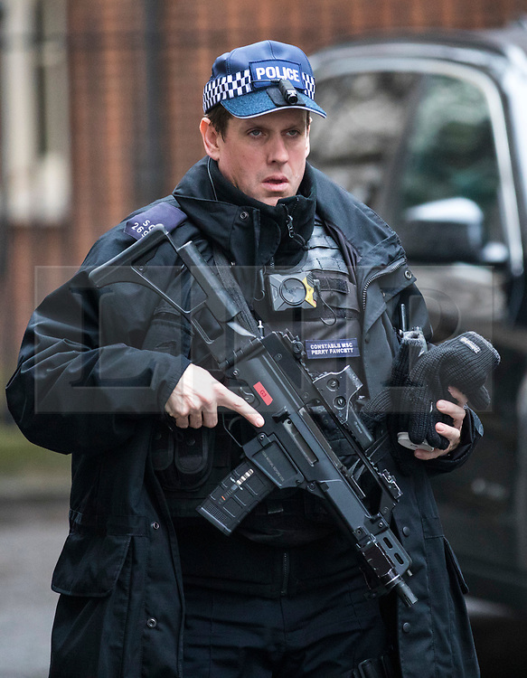 © Licensed to London News Pictures. 20/12/2017. London, UK.  An armed policeman wearing a new head-mounted body camera patrols on Downing Street. The Metropolitan Police have issued the cameras to armed response officers carrying 'overt weapons' in order to provide greater transparency in police shootings. Photo credit: Rob Pinney/LNP