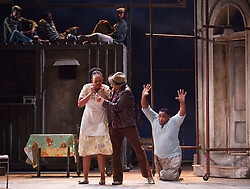 """© Licensed to London News Pictures. 10/07/2012.  London, England. L-R: Nonhlanhla Yende as Bess, Victor Ryan Robertson as Sporting Life and Xolela Sixaba as Porgy. London Premiere of Cape Town Opera's fully-staged production of the Gershwin Opera """"Porgy and Bess"""" at the London Coliseum. A limited season of 14 performances from 11 to 21 July 2012. Directed by Christine Cross, Music/Lyrics by George Gershwin, DuBose and Dorothy Heyward and Ira Gershwin, accompanied by the Orchestra of Welsh National Opera. Photo credit: Bettina Strenske/LNP"""