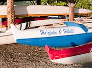 Canoes lined on a beach in Kualoa Regional Park, O'Ahu, Hawai'i