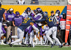 Nov 14, 2020; Morgantown, West Virginia, USA; TCU Horned Frogs wide receiver Taye Barber (4) is tackled by many West Virginia Mountaineers players during the second quarter at Mountaineer Field at Milan Puskar Stadium. Mandatory Credit: Ben Queen-USA TODAY Sports