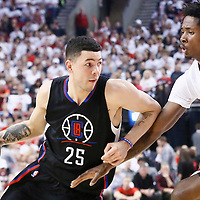 25 April 2016: Los Angeles Clippers guard Austin Rivers (25) drives past Portland Trail Blazers center Ed Davis (17) during the Portland Trail Blazers 98-84 victory over the Los Angeles Clippers, during Game Four of the Western Conference Quarterfinals of the NBA Playoffs at the Moda Center, Portland, Oregon, USA.