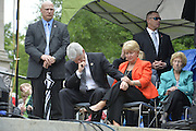 4/13//16 Jackson,MS. Pictured are Governor Phil Bryant and his wife first Lady Deborah holding hands and praying together at the Franklin Graham pray meeting. Evangelist Franklin Graham, Billy Graham's son, speaks on the steps of the Mississippi Capital. Graham held a prayer service Wednesday afternoon as part of his Decision America Tour 2016, where Graham is calling on all Christians to vote. Graham wants all Christians to vote with their religious beliefs and vote Christians into all public offices. Graham's visit comes days after Mississippi Governor passed a controversial Religious Freedom law. Governor Phil Bryant and first Lady Deborah Bryant sat on the Capitol step listening to Franklin and prayed with him. Photo ©Suzi Altman