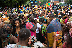 London, August 28th 2016. Hundreds dance to soca  music in the streets during Family Day at Europe's biggest street party, the Notting Hill Carnival.