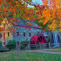 New England fall foliage peak colors at the Wayside Inn Grist Mill in Sudbury, Massachusetts.<br />