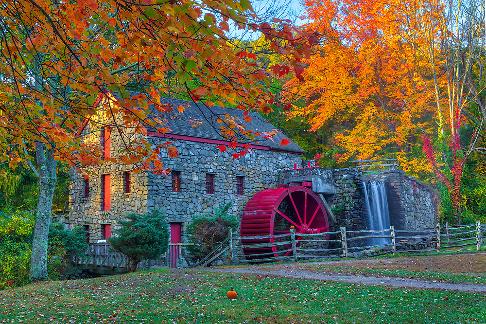 New England fall foliage peak colors at the Wayside Inn Grist Mill in Sudbury, Massachusetts.<br /> <br /> Massachusetts fall foliage photos are available as museum quality photo, canvas, acrylic, wood or metal prints. Wall art prints may be framed and matted to the individual liking and interior design decoration needs:<br /> <br /> https://juergen-roth.pixels.com/featured/autumn-at-the-wayside-inn-grist-mill-juergen-roth.html<br /> <br /> Good light and happy photo making!<br /> <br /> My best,<br /> <br /> Juergen