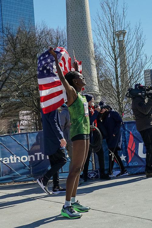 Sally Kipyego celebrates placing third in the 2020 U.S. Olympic marathon trials in Atlanta on Saturday, Feb. 20, 2020. Photo by Kevin D. Liles for The New York Times