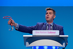 © London News Pictures. 25/09/2013 . Brighton, UK. Nik Johnson, a doctor and Labour parliamentary candidate for Huntingdon, holds up a stethoscope while speaking in a motto on the NHS (National Health Service) on the last day of the  2013 Labour Party Conference at The Brighton Centre. Photo credit : Ben Cawthra/LNP