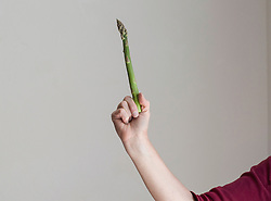 Close-up of a woman showing asparagus