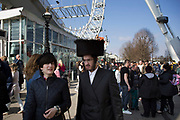 Hassidic Jewish couple at the South Bank on a day out, London, UK.