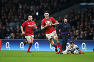 Aaron Shingler of Wales, with bloodied face evades tackle from England's Danny Care (r) and makes a break towards the try line in the 2nd half. England v Wales, NatWest 6 nations 2018 championship match at Twickenham Stadium in Middlesex, England on Saturday 10th February 2018.<br /> pic by Andrew Orchard, Andrew Orchard sports photography