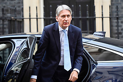 © Licensed to London News Pictures. 24/10/2018. LONDON, UK.  Philip Hammond, Chancellor of the Exchequer, returns to Downing Street from Prime Minister's Question Time.   Photo credit: Stephen Chung/LNP