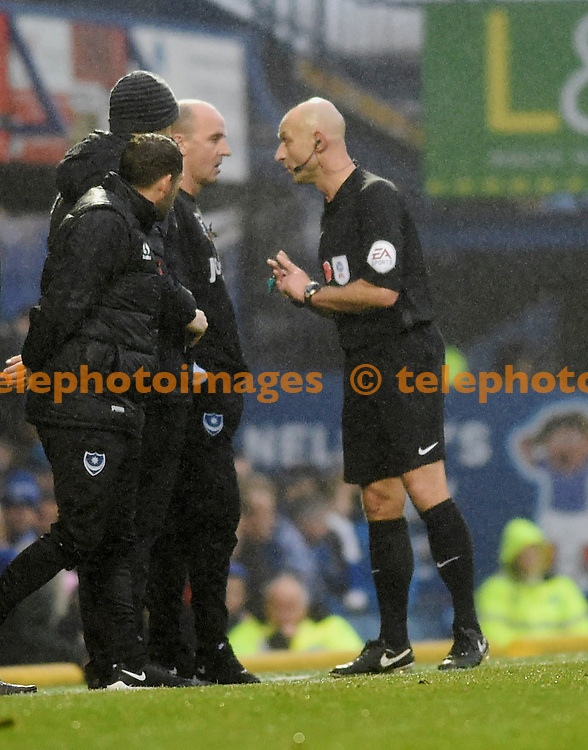 Referee Roger East has a word with Portsmouth manager Paul Cook during the Sky Bet League 2 match between Portsmouth and Mansfield Town at Fratton Park in Portsmouth. November 12, 2016.<br /> Simon  Dack / Telephoto Images<br /> +44 7967 642437