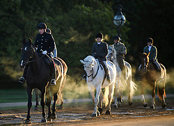© Licensed to London News Pictures. 24/09/2018. London, UK. Steam rises from horses being ridden at sunrise on a cold Autumn morning in Hyde Park, central London. Photo credit: Ben Cawthra/LNP
