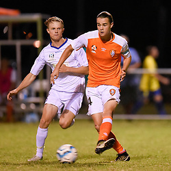 BRISBANE, AUSTRALIA - FEBRUARY 10: Aaron Reardon of the Roar passes the ball under pressure from Rees Duncan of United during the NPL Queensland Senior Mens Round 2 match between Gold Coast United and Brisbane Roar Youth at Station Reserve on February 10, 2018 in Brisbane, Australia. (Photo by Football Click / Patrick Kearney)