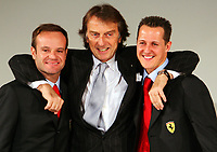 (L to R) Brazilian Ferrari driver Rubens Barrichello, chairman Luca Cordero di Montezemolo and German Michael Schumacher pose for photographers during the official presentation of the new F2005 F1 car at the team's headquarters in Maranello.<br /> <br /> <br /> <br /> Rubens Barrichello, Luca Cordero di Montezemolo e Michael Schumacher durante la presentazione della nuova Ferrari F2005.<br /> <br /> <br /> <br /> Photo Munch / Graffiti