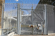 An internal security gate inside HM Prison Wandsworth is a Category B men's prison at Wandsworth in the London Borough of Wandsworth, South West London, United Kingdom. It is operated by Her Majesty's Prison Service and is one of the largest prisons in the UK with a population over 1500 people. (photo by Andy Aitchison)