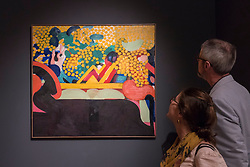 """© Licensed to London News Pictures. 29/06/2017. London, UK.  Members of the public view """"The Meeting"""", 1963-65, by Howard Hodgkin during a visit to Masterpiece London, a leading art fair held in the grounds of the Royal Hospital Chelsea.  The fair brings together 150 international exhibitors presenting works from antiquity to the present day and runs 29 June to 5 July 2017.  Photo credit : Stephen Chung/LNP"""