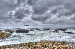 November 24, 2015 - Distant view of tall Torii gate in the middle of a lake under a stormy, cloudy sky. (Credit Image: © Mint Images via ZUMA Wire)