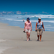 Two ladies walking along the Cocoa beach In Florida
