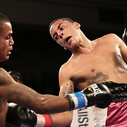 Alex Roman (L) fights against Edgardo Marin during a Telemundo boxing match at the Kissimmee Civic Center on Friday, July 17, 2015 in Kissimmee, Florida. Roman won the bout by unanimous decision. (AP Photo/Alex Menendez)