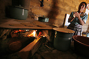 Manuela Chitic Gonasalez, cooks some tortillas for the family at her adobe home inPotrero Viejo, Guatemala.