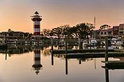 Sunset over Sea Pines Harbor Town lighthouse and marina looking toward Daufuskie Island on Hilton Head Island, South Carolina.