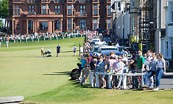 The crowd at the 18th. Former US president Barack Obama playing golf at St Andrews.
